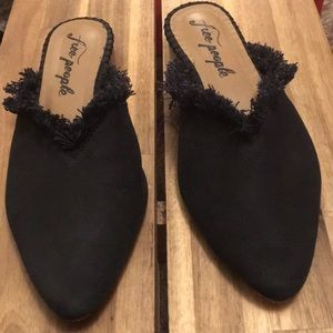 Black leather Free People mules with fabric fringe